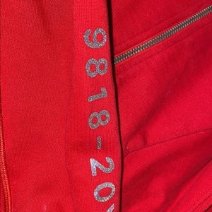 Red limited edition sparkly reflective zip up